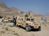 US Army Humvee light wheeled vehicle picture. U.S. soldiers stand near an armored Humvee vehicle in Tagab district of Kapisa province, north of Kabul, Afghanistan on Thursday, Sept. 27, 2007. The U.S. military has launched a new 'Most Wanted' campaign offering rewards of up to US$200,000 for information leading to the capture of 12 Taliban and al-Qaida leaders. Posters and billboards are being put up around eastern Afghanistan with the names and pictures of the 12, with reward amounts ranging from US$20,000 to US$200,000. The list is filled with local insurgent cell leaders responsible for roadside and suicide bomb attacks.