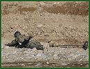 Soldiers from the Afghan National Army's 8th Commando Kandak found and destroyed a rocket cache in Tarin Kowt district, February 23, 2012.