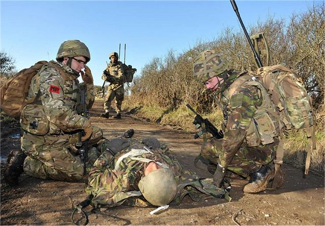 British Soldiers deal with a 'casualty' during the exercise