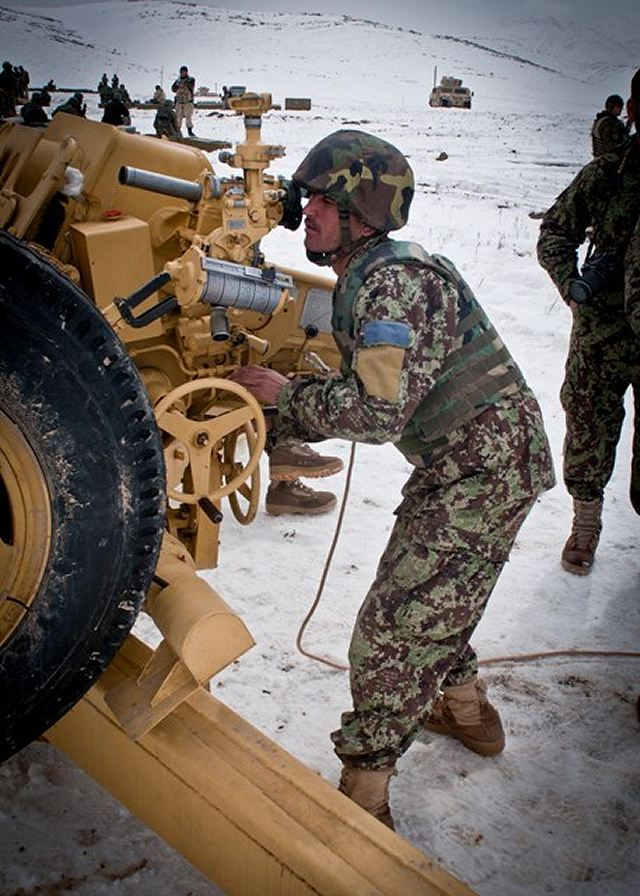 An Afghan National Army soldier, from the 4th Kandak, 2nd Brigade, 203rd Corps, adjusts the sights of a D30 howitzer during a live-fire certification, March 13, 2012