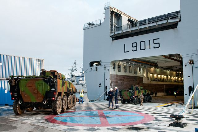 French VBCI wheeled armoured infantry fighting vehicle are loaded on the Dixmude ship of the French Navy, Sunday, January 20, 2013.