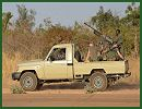 A column of about 30 French tanks and several troop carriers, accompanied by a helicopter, crossed into Mali from Ivory Coast in an international mission to take control of the African nation's north from Islamist extremists, French media reported Monday night, January 14, 2013.