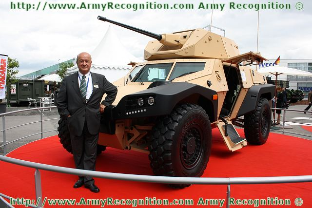 http://www.armyrecognition.com/images/stories/europe/france/exhibition/eurosatory_2012/pictures2/Christian_Mons_Chairman_CEO_Panhard_Defence_near_CRAB_Combat_Reconnaissance_Armoured_Buggy_Eurosatory_2012_001.jpg