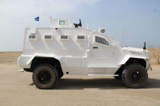 Guardian Xtreme APC 4x4 MRAP Mine Resistant Ambush Protected vehicle IAG United Arab Emirates right side view 001