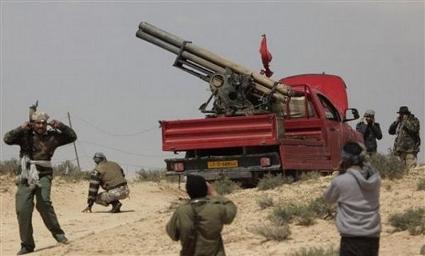 The fighting continues at Brega. Large explosions and machinegun fire was heard this morning. The revolutionaries said that better trained army units are now helping to fight against Gaddafi's forces and have kept less experienced people from the battle.