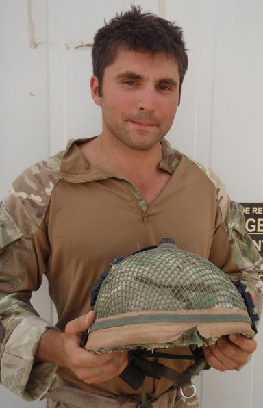 A British soldier has had a miraculous escape after the strap of his helmet Mark 7 was shot off during his first patrol with his new unit in Helmand province.