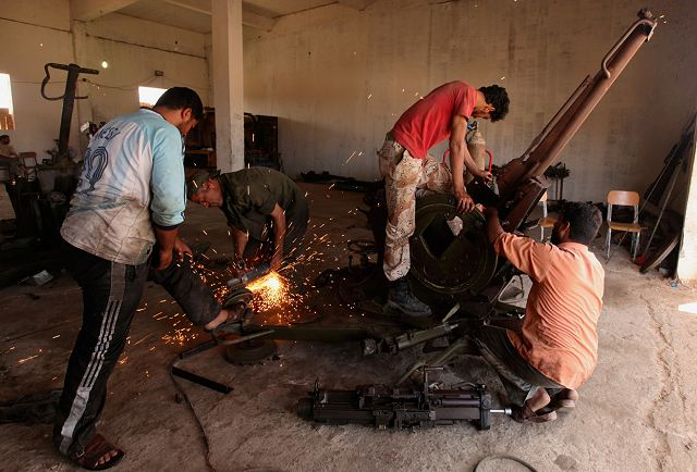 In the city of Benghazi the rebels organize themselves, and workshops of local made weapons and armoured vehicle are created. Mechanics and engineers manufacture weapons to fight the heavy vehicles as main battle tanks of Kaddafi Forces.