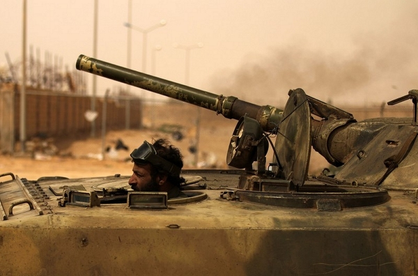Rebels in the eastern Libyan town of Ajdabiyah are trying to fend off an attack by forces loyal to Colonel Gaddafi. The Libyan armed forces has been bombing the area on a regular basis, but has so far failed to dislodge the opposition rebels, who still patrol the streets.