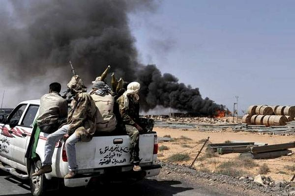 Libyan Rebel forces bore down Monday on Moammar Gadhafi's hometown of Sirte, a key government stronghold where a brigade headed by one of the Libyan leader's sons was digging in to defend the city and setting the stage for a bloody and possibly decisive battle.