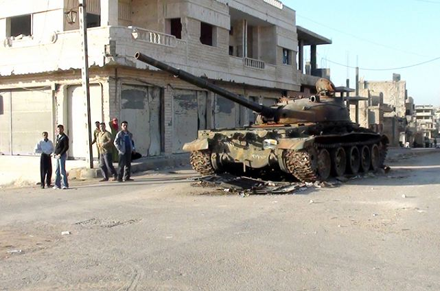 http://www.armyrecognition.com/images/stories/news/2012/may/Syrian_army_T-62_main_battle_tank_destroyed_by_the_rebels_in_Rastan_Homs_province_Syria_001.jpg