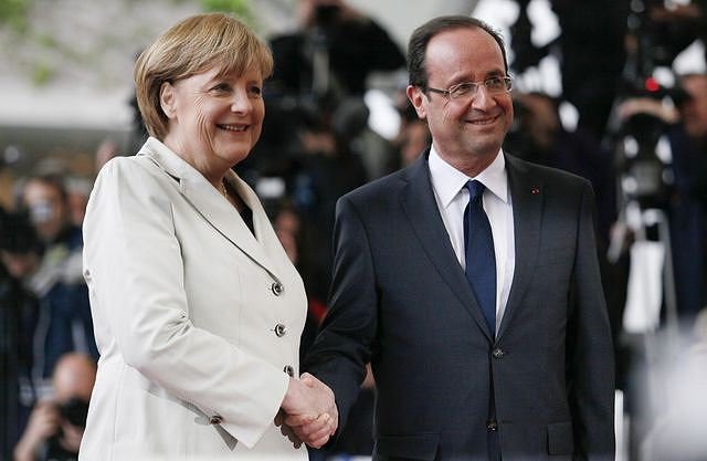 German Chancellor Angela Merkel and French President Francois Hollande held talks in the southwestern German town of Ludwigsburg on Saturday to mark former French president Charles De Gaulle's speech, while the EADS/BAE merger and eurozone banking union weigh heavily on the agenda of the largely ceremonial meeting.