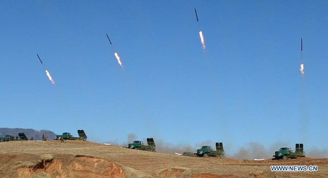 The undated photo provided by Korean Central News Agency (KCNA) on March 14, 2013 shows a live artillery drill of the Democratic People's Republic of Korea (DPRK) at the southwest sector of the front line.