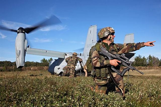 Legionnaires from the 2nd Foreign Infantry Regiment of France's 6th Light Armored Brigade set up landing zone security for an MV-22B Osprey with Special-Purpose Marine Air-Ground Task Force Crisis Response Oct. 30, 2013, at Camp des Garrigues, France.