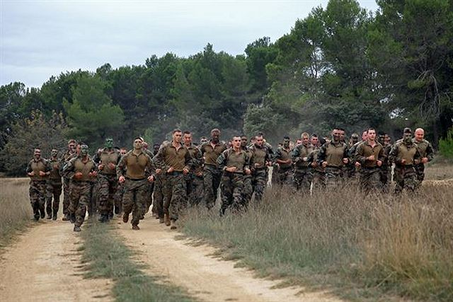 U.S. Marines with Special-Purpose Marine Air-Ground Task Force Crisis Response and Legionnaires with the 2nd Foreign Infantry Regiment of France's 6th Light Armored Brigade take part in a 7K obstacle course after conducting a heliborne raid Oct. 31, 2013, at Camp des Garrigues, France.