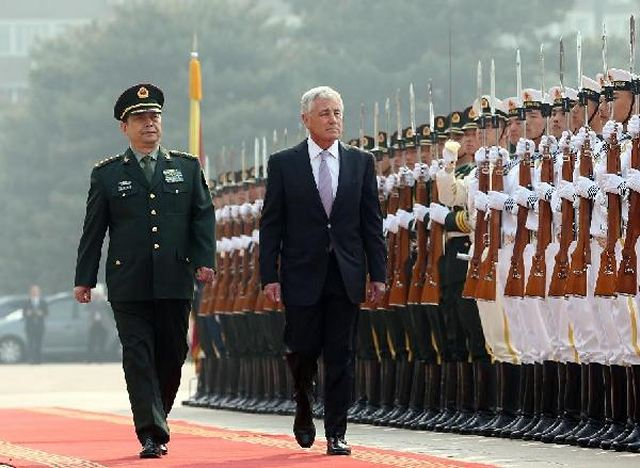 Chinese Defense Minister Chang Wanquan held talks with his U.S. counterpart Chuck Hagel on promoting the sound and stable development of a new type of military relations. Chang said this year marks the 35th anniversary of the establishment of bilateral relations, and it is also a crucial year for the two sides to build the new type of major-country relations.