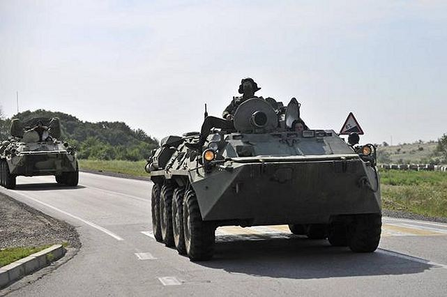 Russia continues to build up its military presence in close proximity to the border with Ukraine, National Security and Defense Council (NSDC) spokesman Andriy Lysenko has said, on Thursday, July 24, 2014. Lysenko also said that in a forest not far from the villages of Churovichi, Zeleny Kut and Rudnya-Tsata in the Bryansk region, ten kilometers from the border with northern Ukraine, Russia continued to equip camouflaged firing positions of infantry fighting vehicles.