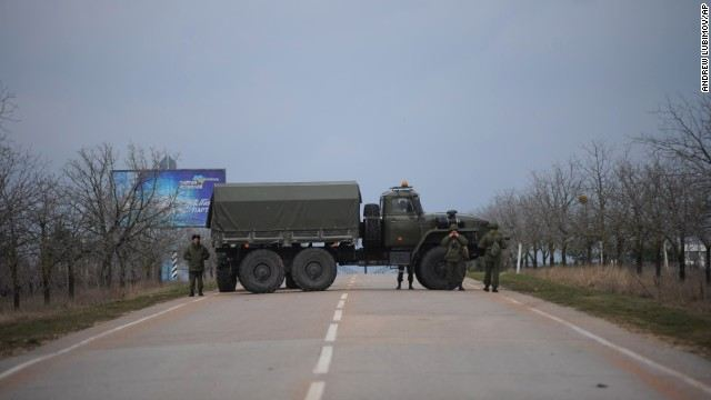 Russian troops blocked a road February 28 near the military airport in Sevastopol, Ukraine, on the Black Sea coast.