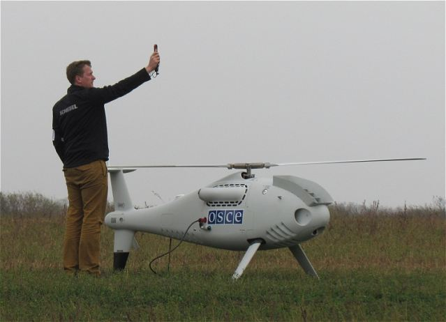 The OSCE (Organization for Security and Cooperation in Europe) Special Monitoring Mission to Ukraine (SMM) October 23, 2014, successfully completed the maiden flight of its unarmed/unmanned aerial vehicles (UAVs) before members of the media near Mariupol in eastern Ukraine. The roll-out of the UAV operations in eastern Ukraine will continue Friday with, weather permitting, routine operational flights.
