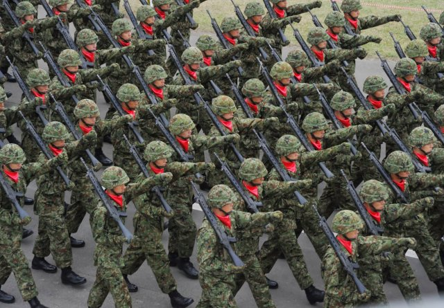 Japan parliamentary committee approved bill to allow country s troops to fight abroad 640 001