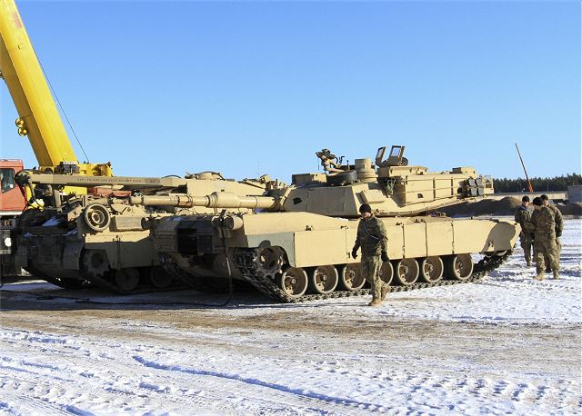 US Army soldiers of 68th Armor Regiment with M1A2 Abrams and M2A3 Bradley on ground in Latvia 640 001