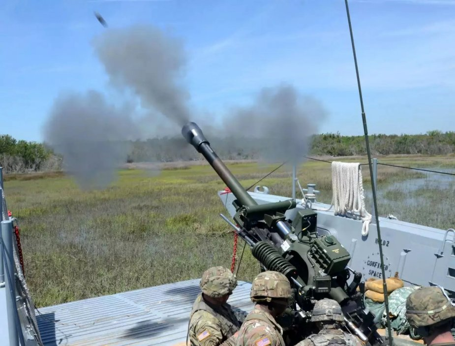 US field artillery fired M119 howitzer from landing craft in Operation Gator 2