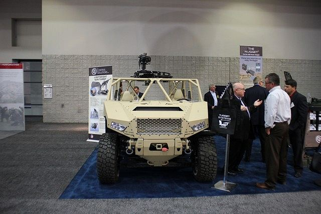 At AUSA 2015, American Company Control Solutions presents its Light Weight Gun Turret fiited on all-terrain vehicle Polaris Dagor. The Lightweight Motorized Gun Turret (LMGT) provides a new one-piece system that can be easily mounted on almost any vehicle. Reducing the vehicle weight will continue to be a key requirement of military and police forces worldwide.