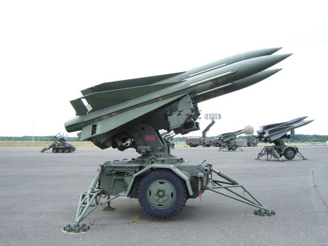 M192 Launcher unit (LCHR): LCHR supports up to three ready to fire missiles and is activated only on the initiation of the fire cycle. When the fire button is activated in the BCC or PCP, several launcher functions occur simultaneously: the launcher slew's to designated azimuth and elevation angles, power is supplied to activate the missile gyros, electronic and hydraulic systems, the launcher activates the missile motor and launches the missile.