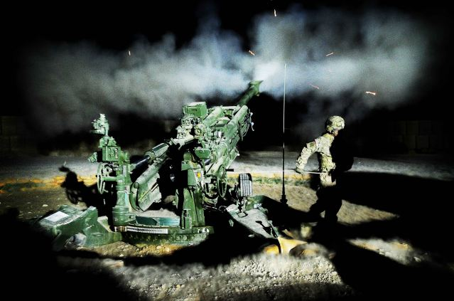 A United States gun crew fires illumination rounds at Forward Operating Base Hadrian. The 1st Section Bravo Battery 1-9 Field Artillery from Fort Stewart, Ga., have been conducting intensive training and fire missions to support operations in Uruzgan province, Afghanistan.
