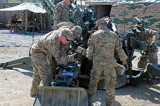 U.S. Army Soldiers with Battery A, 2nd Battalion, 320th Field Artillery, 1st Brigade Combat Team, 101st Airborne Division, practice using the Enhanced Portable Inductive Artillery Fuse Setter on a XM1156 Precision Guidance Kit Fuse and the M795 Rocket-Assisted Projectile April 28, 2013 at Forward Operating Base Joyce, Kunar Province, Afghanistan.
