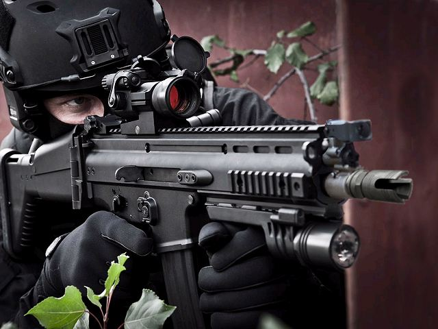 The SCAR®, is a modular rifle designed and developed by the Belgian Fabrique Nationale de Herstal in cooperation with the U.S. Special Operations Command (SOCOM) to satisfy the requirements of the SCAR (Special Operations Forces Combat Assault Rifle) competition.